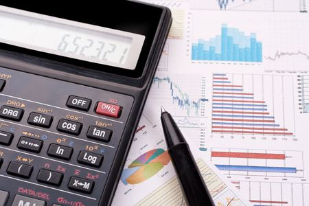 financial statement with calculator and pen
