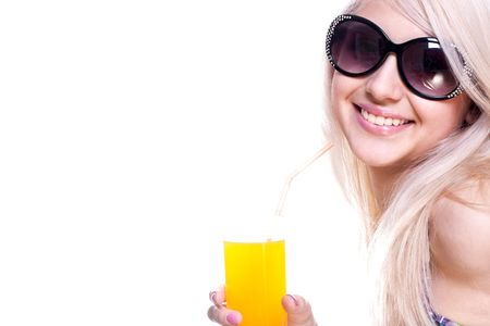 beautiful women in swimsuit with a glass of juice on a white background isolated Banque d'images