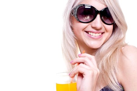 beautiful women in swimsuit with a glass of juice on a white background isolated Stock Photo