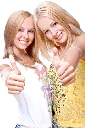 two beautiful women giving thumbs-up on a white background