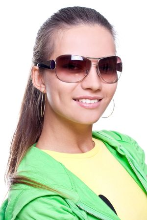 woman in a yellow shirt and green jacket posing on a white background photo