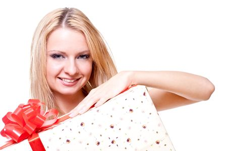 beautiful woman with holiday gift on a white background photo