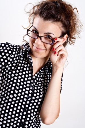 beautiful woman in a black polka dot dress with glasses