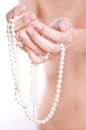 ornament of pearls in the womens hands photo