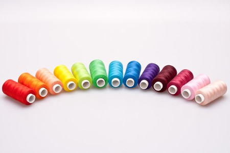 multi-colored rainbow threads for sewing photo