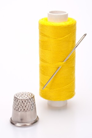 darn: spool of thread for sewing with needle and thimble