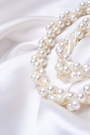 jewels on white satin as a background Stock Photo
