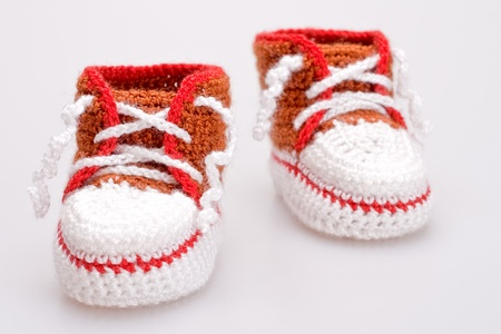 crocheted booties for a boy on a gray background Stock Photo - 9613752