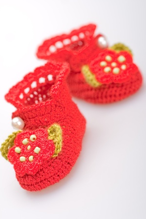 crocheted booties for a girl on a gray background photo