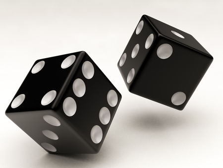 two black dices falling on a white background photo