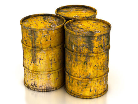 сhemical yellow old barrels on a white background Stock Photo