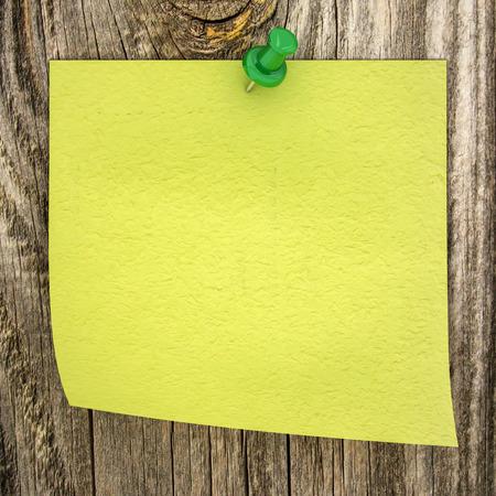 sticky paper on a wood background