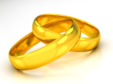 golden wedding rings on a white background Banque d'images