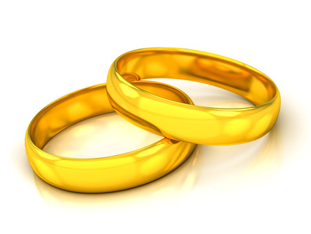 golden wedding rings on a white beckground Banque d'images