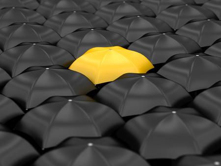 unique yellow umbrella with many black umbrellas Banque d'images