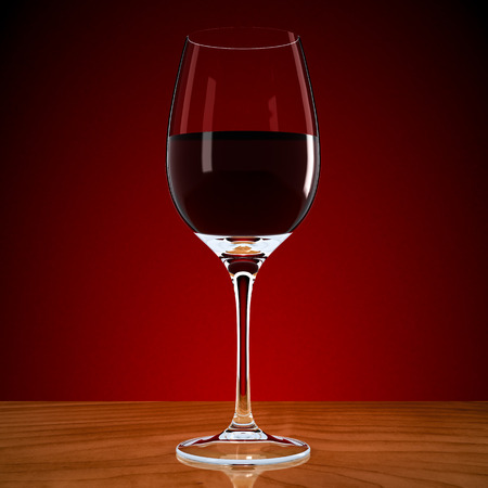 dinner party table: wineglass with wine on a red background Stock Photo