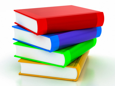 multi-colored books stack on a white backround Banque d'images