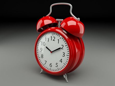 analog retro alarm clock on a gray background Banque d'images