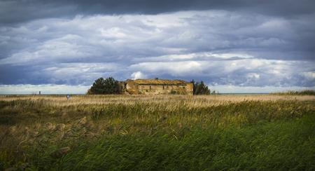 abandoned farmhouse abandoned farmhouse: Old abandoned farmhouse near the sea, in a meadow, under a cloudy sky
