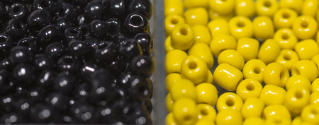 small articles: Lots of colorful plastic fusible beads used for arts and craft. Stock Photo