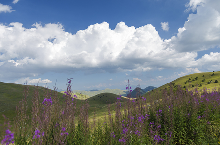 Panoramic view of beautiful landscape with Italian Gran Sasso peak at Campo Imperatore plateau in the Apennine Mountains, Abruzzo, Italy