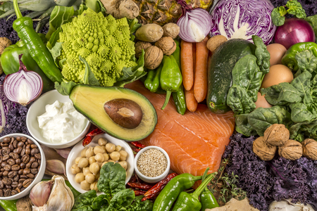 table top full of fresh vegetables, fruit, and other healthy foods