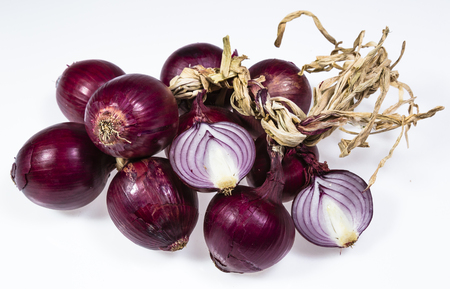 diuretic: Fresh sliced ??onions and red bulbs on white background