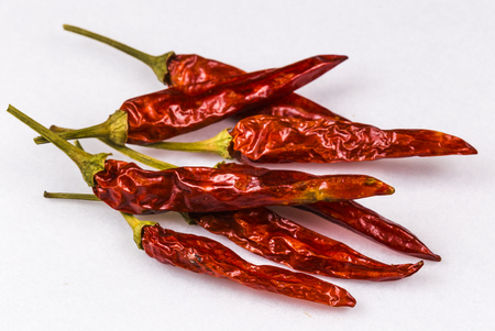 dried red chili pepper on white background Stock Photo