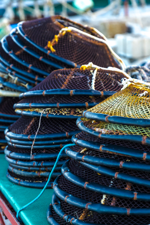commercial fishing: Fishing pots stucked on each other in an italian fishing village Stock Photo