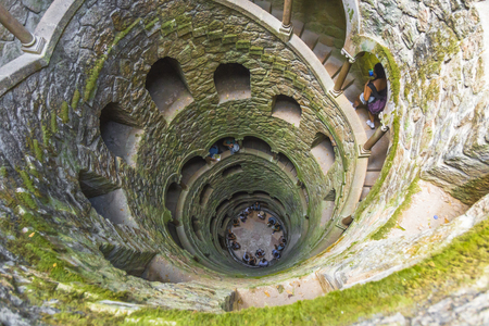 Looking down into the 'Initiation Well' into the 'Quinta da Regaleira' park in Sintra 스톡 콘텐츠