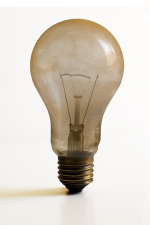burned out: Old technology and wasting electricity, burned out light bulb