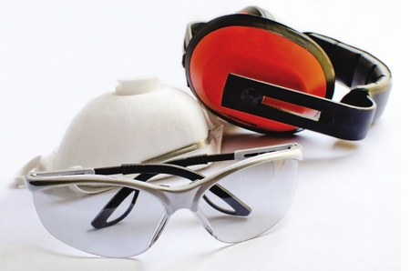 earmuffs: Protective equipment - Protective glasses earmuffs and dust mask Stock Photo