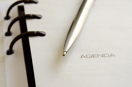 Ballpoint pen over an opened agenda photo