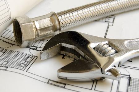 Plumbing tools on house blueprint Stock Photo - 10345798