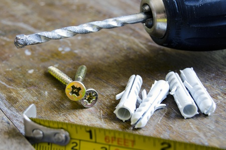 dowel: Detail of construction tools over a wooden table Stock Photo