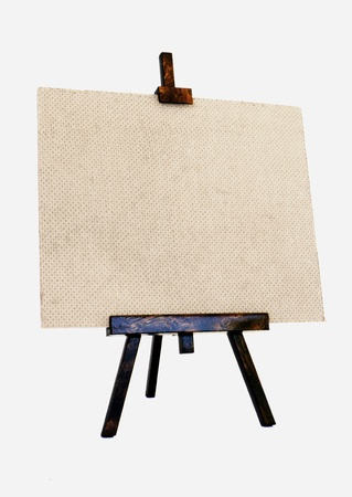 Empty canvas on a wooden tripod photo