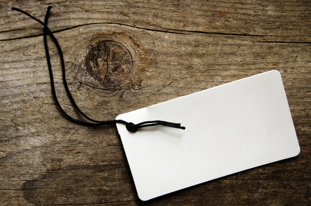 Empty tag over a textured wooden background Stock Photo - 12467443