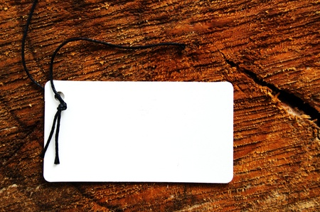 Empty tag over a textured stump background Stock Photo - 12467431