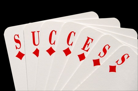 Success concept with playing cards photo