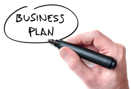 Hand writing Business Plan on whiteboard Stock Photo
