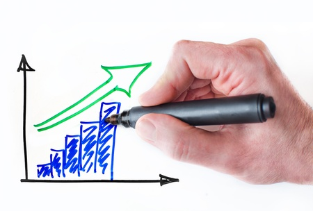 increase sales: Hand drawing growing graph on whiteboard Stock Photo