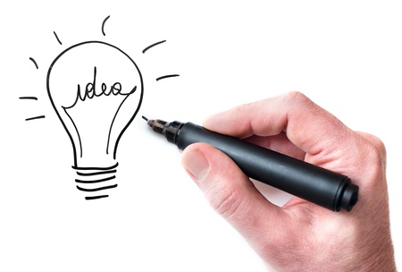 Hand drawing Idea bulb on whiteboard Stock Photo
