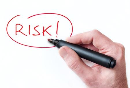 Hand writing Risk on whiteboard photo