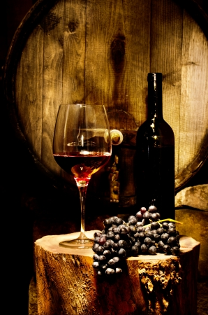 wine grapes: Still life with red glass of wine in the cellar Stock Photo