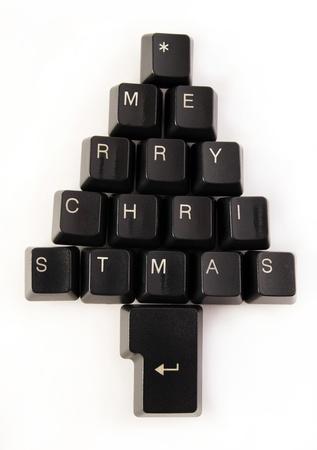 plastic christmas tree: Keyboard keys wishing a merry Christmas