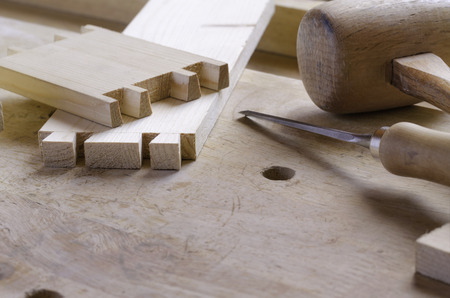 assembling: Detail of a dovetail joint before assembling parts