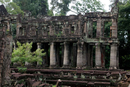 Ancient Ta prohn temple in Angkor, silk-cotton tree consumes the ancient ruins in Cambodia photo