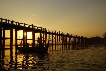 U bein bridge at sunset in Amarapura near Mandalay, Myanmar (Burma)