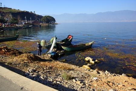 People fishing on Erhai lake near Dali, Yunnan province, China photo
