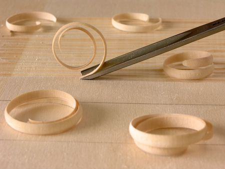 carving tool: wood shavings and carving tool       Stock Photo